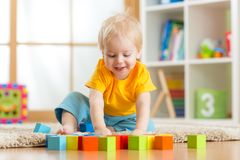 Kid boy playing wooden toys Royalty Free Stock Images
