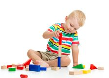 Kid boy playing  wooden toys Royalty Free Stock Photo
