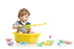 Kid boy plays fishing Stock Photos