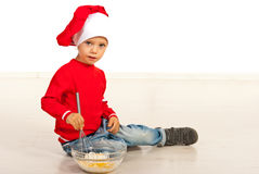 Kid boy preparing food Royalty Free Stock Photos