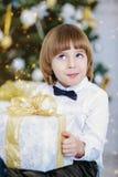 Kid boy with present stock image