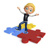 Kid boy with puzzel Stock Photo