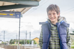 Kid boy on railway station. Waiting for train Royalty Free Stock Photos