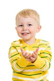Kid boy reaches his hands Stock Images