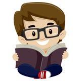 Kid Boy Reading a Book Stock Photos