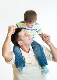 Kid boy riding dad's shoulders isolated on white. Background royalty free stock image