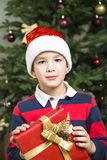 Christmas chikd with present box. royalty free stock photo