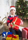 Christmas chikd with present box. stock photos