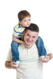 Kid boy sitting on dad's shoulders Stock Image