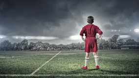 Kid boy on soccer field Stock Photos