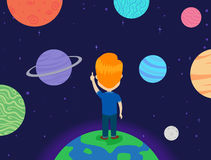 Kid Boy standing on Earth looking at the Planets Royalty Free Stock Images