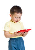 Kid boy with tablet pc, early learning Stock Photo