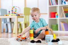 Kid boy toddler playing car toys at home Royalty Free Stock Photography