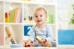 Kid boy toddler playing at home Stock Photo