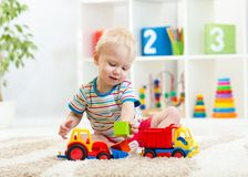 Kid boy toddler playing with toy car Royalty Free Stock Photo