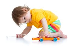 Kid boy toddler playing with toy Royalty Free Stock Image