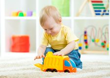 Kid boy toddler playing with toy car Royalty Free Stock Images