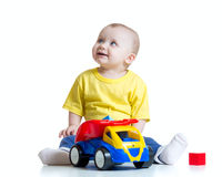Kid boy toddler playing with toy car Stock Photo