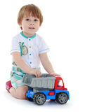 Kid boy toddler playing with toy car Stock Photos