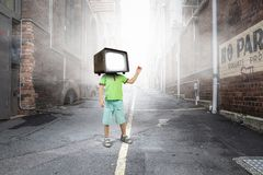 TV addicted children. Mixed media Stock Photos