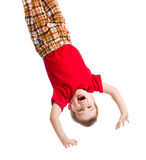 Kid boy upside down isolated. On white Stock Image