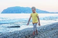 Kid boy walking Stock Image