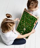 Kid boy watch kid girl playing educational game that developes coordination. Kid boy watch kid girl playing educational game that improve coordination on white stock image