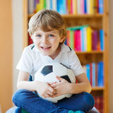 Kid boy watching soccer or football game on tv Royalty Free Stock Photography