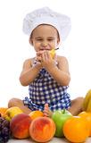 Kid boy wearing a chef hat with healthy food fruits. Isolated Stock Image