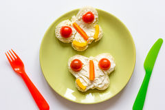 Kid breakfast butterfly sandwiches top view on white background Stock Photo