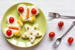 Kid breakfast butterfly sandwiches top view on wooden background Royalty Free Stock Photo
