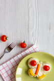 Kid breakfast butterfly sandwiches top view on wooden background Stock Images