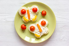 Kid breakfast butterfly sandwiches top view on wooden background Stock Image