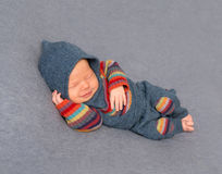 Kid in a bright outfit, sleeping Stock Image