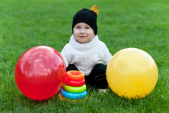 Kid with bright toys Stock Photo