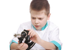 Kid with broken microscope Stock Photos