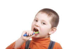 Kid brushing teeth Stock Photos