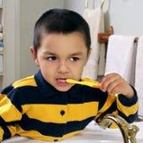 Kid brushing teeth Royalty Free Stock Image