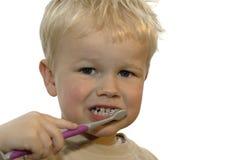 Kid brushing teeth. Three year old brushing his teeth stock photography