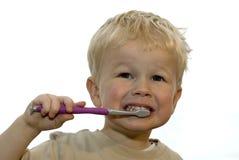 Kid brushing teeth. Three year old brushing his teeth royalty free stock image
