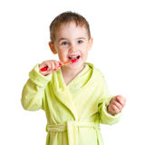 Kid brushing teeth isolated Stock Images
