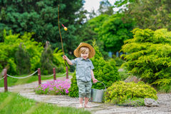 Kid with bucket and rod Royalty Free Stock Image