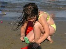 Kid Building A Castle At The Beach Stock Photos