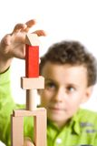 Kid building a castle Royalty Free Stock Photos
