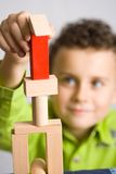 Kid building a castle Royalty Free Stock Image