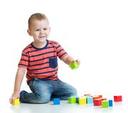 Kid building tower with colorful blocks isolated Royalty Free Stock Images
