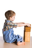 Kid builds a tower of blocks Stock Images