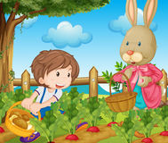 Kid and bunny picking out vegetables Royalty Free Stock Photo