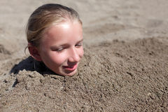 Kid buried in sand Royalty Free Stock Image