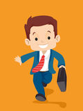 Kid in Business Suit carrying a suitcase while walking Stock Image